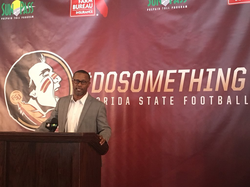 FSU head coach Willie Taggart hits the stage in Charlotte